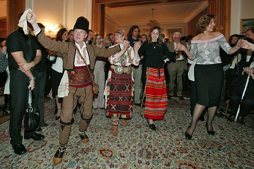 The dance is led by James MacDonald Reid in national Bulgarian costume.